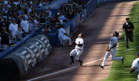 Dougie and Robinson Cano chasing down a foul ball