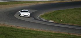 "Miata in the Esses at Lime Rock Park - photo courtesy of <a href=""http://www.flickr.com/photos/jessicow/\"">Jessica</a>."